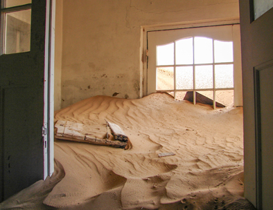 house covered in sand - kolmanskop