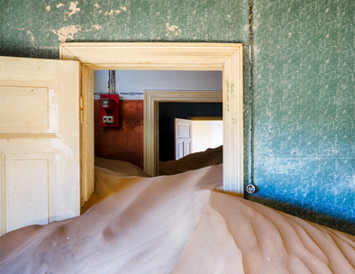 The abandoned town is filled with desert sand